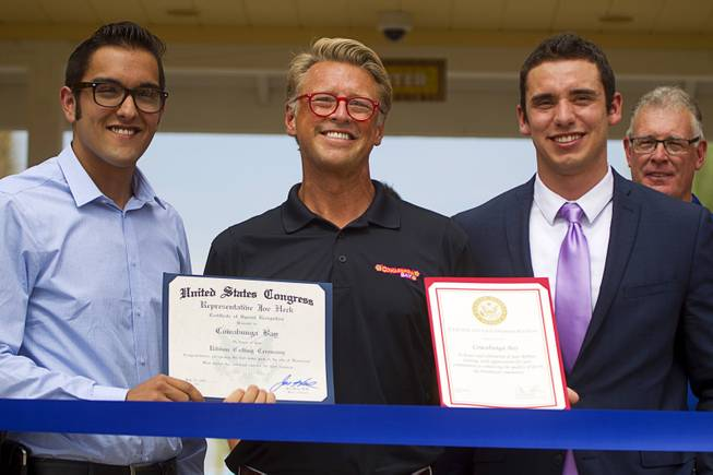Shane Huish, center, general manager of the Cowbunga Bay water park, poses with Andrew Turcaz, left, representing Congressman Joe Heck, and Stephen Sifuentes, representing Sen. Dean Heller, during an official opening ceremony for the water park in Henderson Monday, July 14, 2014. The park opened on July 4. STEVE MARCUS