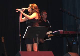 Amanda Avila performs with Venus Rising on Saturday, July 12, 2014, in the Lounge at Excalibur.