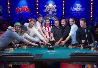 Members of the November Nine reach for the championship bracelet after making it to the Final Table during the World Series of Poker $10,000 Buy-In No-Limit Texas Hold 'em Main Event at the Rio on Tuesday, July 15, 2014. Players from left: Billy Pappaconstantinou of Lowell, Mass.; Felix Stephensen of Norway; Jorryt van Hoof of the Netherlands; Mark Newhouse of Los Angeles, who now lives in Las Vegas; Andoni Larrabe of Spain; William Tonking of Flemington, N.J.; Daniel Sindelar, originally from Columbus, Neb., now living in Las Vegas; Martin Jacobson of Sweden; and Bruno Politano of Brazil.