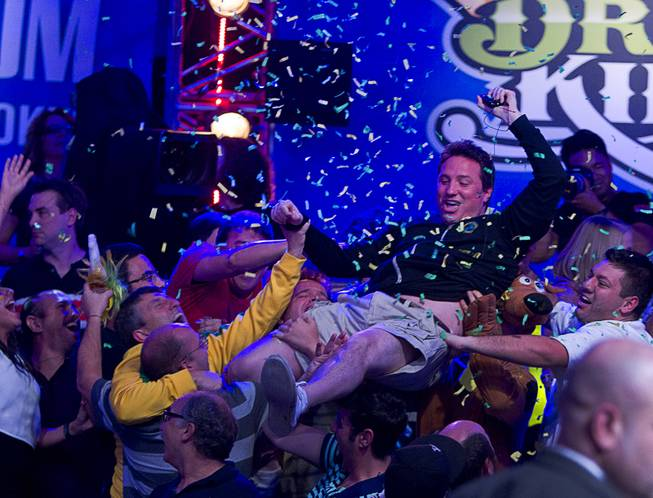 Bruno Politano of Brazil celebrates with supporters after making it to the final table during the World Series of Poker $10,000 buy-in No-limit Texas Hold 'em main event at the RioTuesday morning, July 15, 2014.