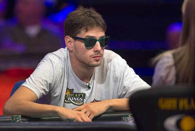 Mark Newhouse, the ninth-place finisher in 2013, competes during the World Series of Poker $10,000 buy-in No-limit Texas Hold 'em main event at the Rio Monday, July 14, 2014. Newhouse, originally from Chapel Hill, N.C., made it to the final table.