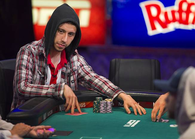 Andoni Larrabe of Spain competes during the World Series of Poker $10,000 buy-in No-limit Texas Hold 'em main event at the Rio Monday, July 14, 2014. Larrabe made it to the final table.