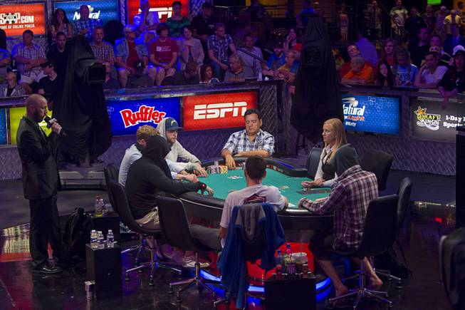 Poker players compete during the World Series of Poker $10,000 buy-in No-limit Texas Hold 'em main event at the Rio Monday, July 14, 2014.