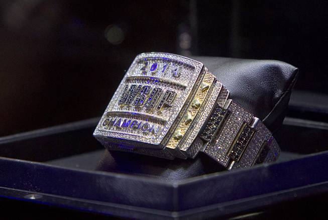 The championship bracelet is displayed during the World Series of Poker $10,000 buy-in No-limit Texas Hold 'em main event at the Rio Monday, July 14, 2014.