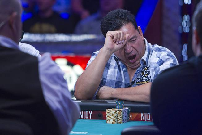 Luis Velador of Corona, Calif. yawns during the World Series of Poker $10,000 buy-in No-limit Texas Hold 'em main event at the Rio, July 14, 2014. Velador finished in 10th place.