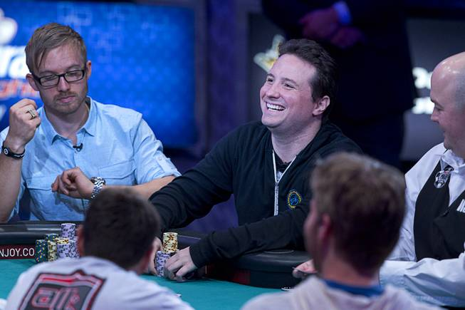 Bruno Politano of Brazil smiles after winning a hand during the World Series of Poker $10,000 buy-in No-limit Texas Hold 'em main event at the Rio, July 14, 2014. Politano made it to the final table. Politano is the first Brazilian to make the WSOP Main Event final table.