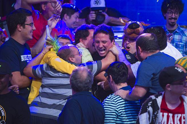 Bruno Politano, center, of Brazil celebrates with supporters after making it to the final table during the World Series of Poker $10,000 buy-in No-limit Texas Hold 'em main event at the Rio, July 14, 2014. Politano is the first Brazilian to make the WSOP Main Event final table.