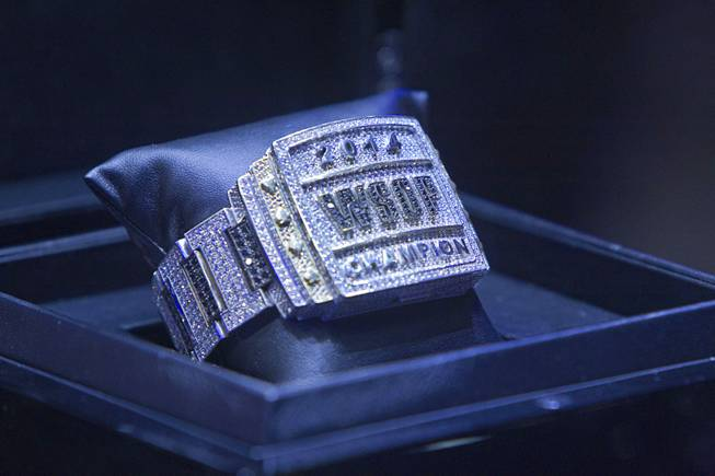 The championship bracelet is displayed during the World Series of Poker $10,000 buy-in No-limit Texas Hold 'em main event at the Rio Tuesday, July 15, 2014.