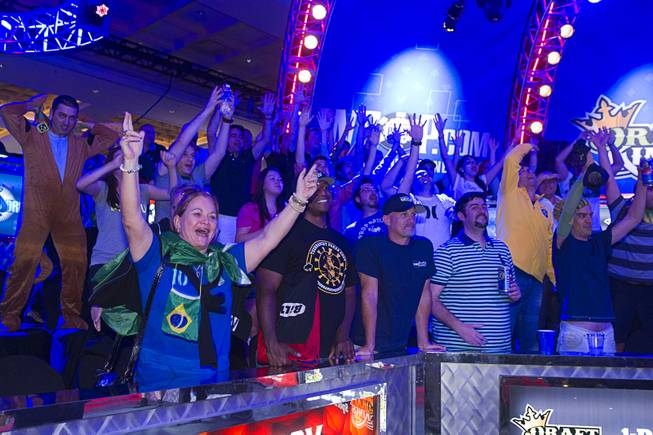 Supporters of Bruno Politano of Brazil celebrate after Politano made it to the final table during the World Series of Poker $10,000 buy-in No-limit Texas Hold 'em main event at the Rio, July 14, 2014. Politano is the first Brazilian to make the WSOP Main Event final table.