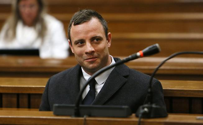 In this Tuesday, July 8, 2014, file photo Oscar Pistorius sits in the dock in Pretoria, South Africa, at his murder trial for the shooting death of his girlfriend Reeva Steenkamp on St. Valentine's Day, 2013.