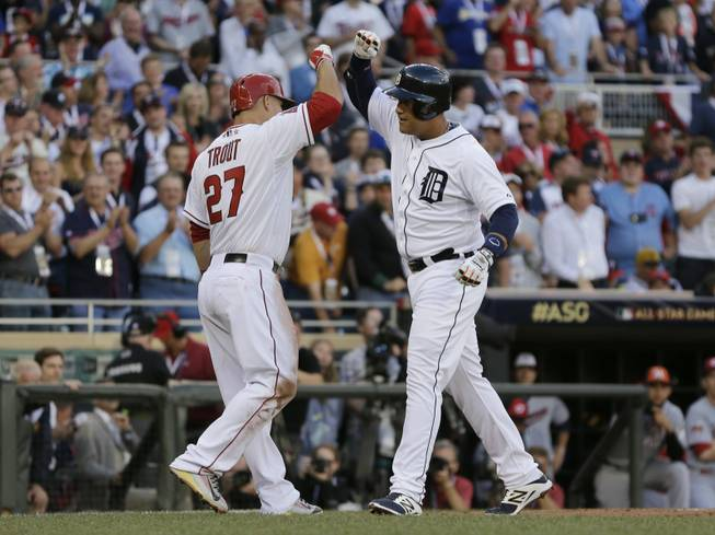 Miguel Cabrera, of the Detroit Tigers, celebrates with Mike Trout, of the Los Angeles Angels, after hitting a home run during the first inning of the MLB All-Star game Tuesday, July 15, 2014, in Minneapolis.