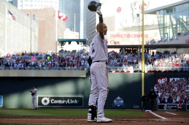 New York Yankees shortstop Derek Jeter waves to the crowd during the first inning of the MLB All-Star baseball game Tuesday, July 15, 2014, in Minneapolis.