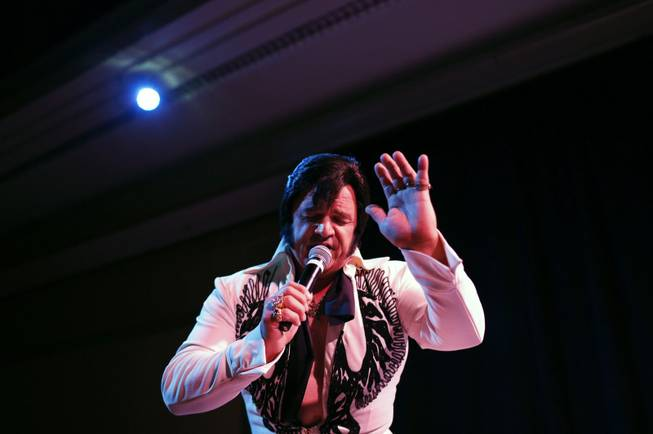 In this July 12, 2014 photo, Tony Freitas, of Oakdale, Calif., performs during the Las Vegas Elvis Festival in Las Vegas. Some three dozen Elvis tribute artists took their gyrating hips and curled lips to the stage over the weekend to see who could do the most convincing portrayal.