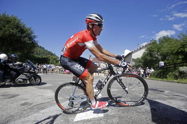 Switzerland's Martin Elmiger climbs in the breakaway during the eleventh stage of the Tour de France cycling race over 187.5 kilometers (116.5 miles) with start in Besancon and finish in Oyonnax, France, Wednesday, July 16, 2014.
