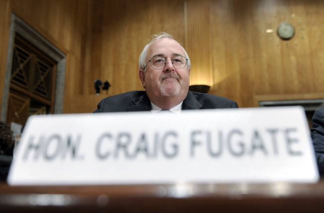 Federal Emergency Management Agency (FEMA) Administrator Craig Fugate prepares to testify on Capitol Hill in Washington, Wednesday, July 9, 2014, before the Senate Homeland Security and Governmental Affairs Committee hearing on the problems with the increased rise in apprehensions at the Southern border. Top Obama administration officials told senators Wednesday they're struggling to keep up with the surge of immigrants at the Southern border.