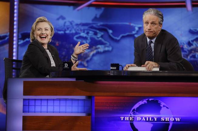 "Former U.S. Secretary of State Hillary Rodham Clinton reacts to host Jon Stewart during a taping of ""The Daily Show with Jon Stewart,"" Tuesday, July 15, 2014, in New York."