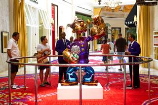 A Popeye sculpture is displayed in the Wynn Esplanade Thursday, July 17, 2014. The stainless steel sculpture, by American artist Jeff Koons, was purchased at auction for $28.2 million.