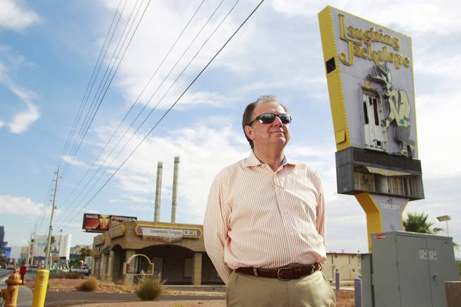 Real estate broker Ric Truesdell is seen outside the shuttered Laughing Jackalope on the south end of the Strip Tuesday, July 15, 2014.