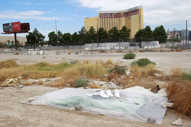 The belongings of a homeless person are covered by a tarp on the south end of the Strip Tuesday, July 15, 2014.