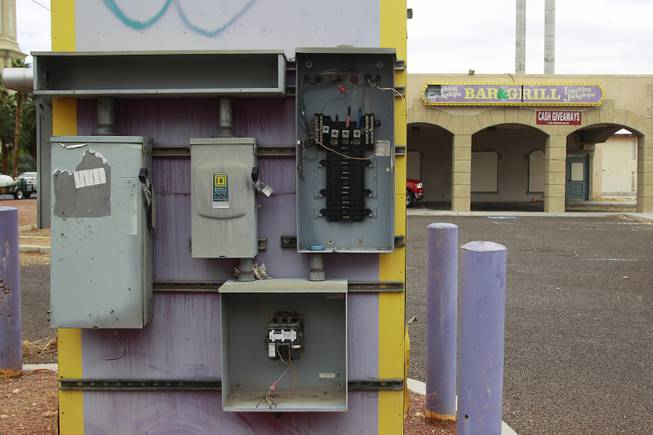 Vandalized electrical boxes are seen on the sign for the shuttered Laughing Jackalope on the south end of the Strip Tuesday, July 15, 2014.