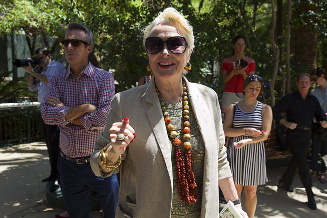 Lynnette Chappell, who played the Evil Queen in Siegfried & Roy's stage show, attends an introduction of white lion cubs at Siegfried & Roy's Secret Garden and Dolphin Habitat Thursday, July 17, 2014. Siegfried Fischbacher and Roy Horn introduced the three 14-week-old cubs, born in South Africa, which will bring new genes into Siegfried and Roy's conservation program.