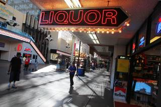 A neon sign advertises liquor for sale at the Fremont Street Experience Thursday, July 17, 2014.