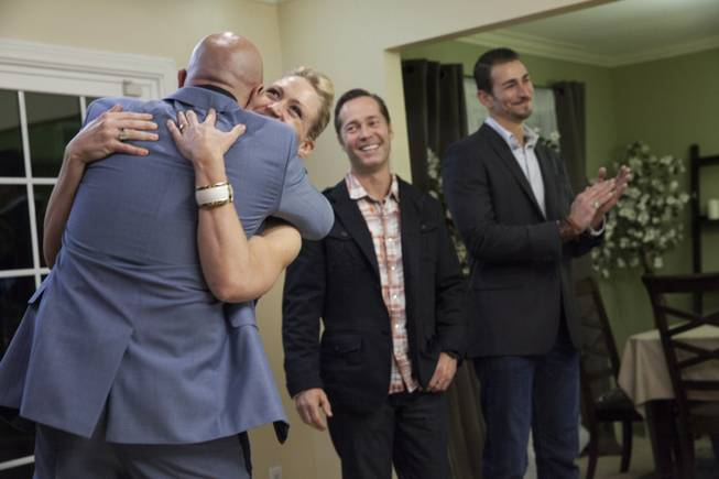 "Interior designer Melissa Roche of Las Vegas competes in Season 2 of ""Brother vs. Brother"" on HGTV. Eric Eremita and Roche of Team Drew and Rick Schwarz and Adi Shuruk of Team Jonathan react as Team Drew is named the winner of the sixth and final challenge in West Hills, Calif. Roche, part of Team Drew, was crowned the champion on the finale Sunday, July 13, 2014."