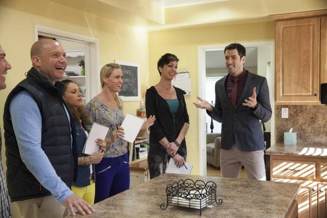 "Interior designer Melissa Roche of Las Vegas competes in Season 2 of ""Brother vs. Brother"" on HGTV. Drew Scott, right, talks with his team, from left, Thomas Brown, Eric Eremita, Drea Clark, Roche and Six about the potential for improving the Hodge house in Northridge, Calif. Roche was crowned the champion on the finale Sunday, July 13, 2014."
