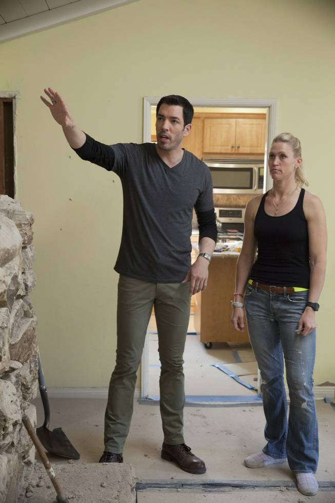 "Interior designer Melissa Roche of Las Vegas competes in Season 2 of ""Brother vs. Brother"" on HGTV. Drew Scott checks in with Roche in the larger living room of the Hodge house in Northridge, Calif. Roche, part of Team Drew, was crowned the champion on the finale Sunday, July 13, 2014."