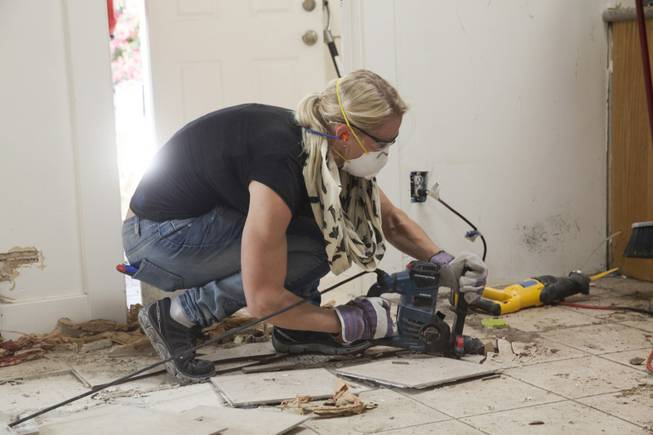 "Interior designer Melissa Roche of Las Vegas competes in Season 2 of ""Brother vs. Brother"" on HGTV. Roche, pictured here, breaks up the tile floor in the kitchen of the McMahan home in the Arlington Heights neighborhood of Los Angeles. Roche, part of Team Drew, was crowned the champion on the finale Sunday, July 13, 2014."