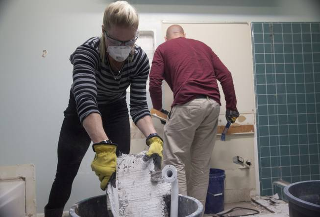 "Interior designer Melissa Roche of Las Vegas competes in Season 2 of ""Brother vs. Brother"" on HGTV. Roche and Eric Eremita start demolition in the master bathroom of the Lousteau home in the West Hills neighborhood of Los Angeles. Roche, part of Team Drew, was crowned the champion on the finale Sunday, July 13, 2014."