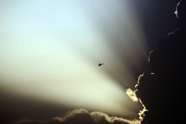 AP10ThingsToSee - A U.S. helicopter flies during clashes between Taliban fighters and Afghan government forces in Kabul, Afghanistan, Thursday, July 17, 2014. Gunmen launched a pre-dawn attack on the Kabul International Airport in the Afghan capital on Thursday.