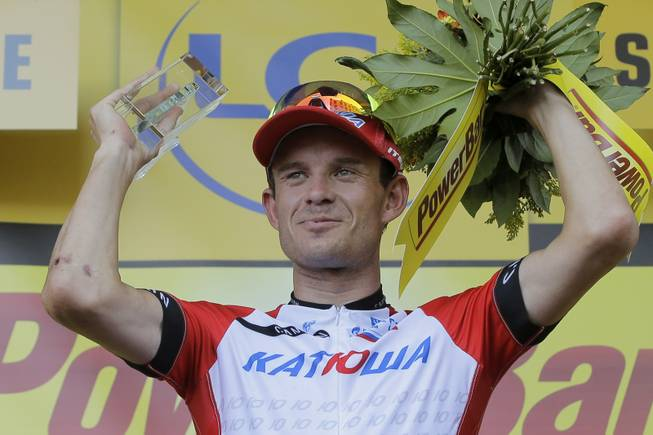 Stage winner Norway's Alexander Kristoff celebrates on the podium of the twelfth stage of the Tour de France cycling race over 185.5 kilometers (115.3 miles) with start in Bourg-en-Bresse and finish in Saint-Etienne, France, Thursday, July 17, 2014.