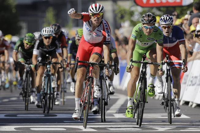Norway's Alexander Kristoff crosses the finish line ahead of Peter Sagan of Slovakia, second right, and France's Arnaud Demare, right, to win the twelfth stage of the Tour de France cycling race over 185.5 kilometers (115.3 miles) with start in Bourg-en-Bresse and finish in Saint-Etienne, France, Thursday, July 17, 2014.