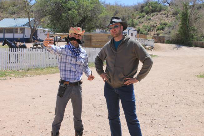 "Misha ""10 Pack"" Furmanczyk confers with videographer Mike Thompson during the recording of Melody Sweets' ""Shoot 'em Up"" video at Grand Canyon Ranch on April 22, 2014."
