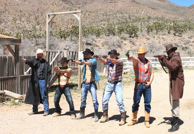 "The ""Absinthe"" Cowboys, from left, Jake Alberda, Ming Hukari, Misha ""10 Pack"" Furmanczyk, Sergie Matvienko, Lucasz Sczerba and Kyle Vonn Elzey during the video shoot for Melody Sweets' ""Shoot 'em Up"" at Grand Canyon Ranch on April 22, 2014."