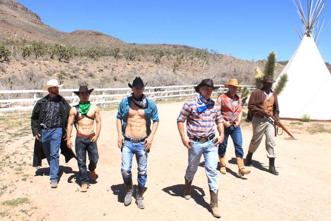 "The unlikely cowboy lineup of, from left, Jake Alberda, Ming Hukari, Misha ""10 Pack"" Furmanczyk, Sergie Matvienko, Lucasz Sczerba and Kyle Vonn Elzey, during the video shoot for Melody Sweets' ""Shoot 'em Up"" at Grand Canyon Ranch on April 22, 2014."