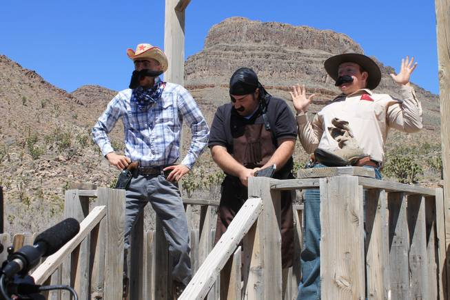 "Members of ""Absinthe,"" from left, Misha Furmanczyk, Daniel Kells (the show's company manager) and Paul Lopez (who portrays high-wire artist Fat Frank) during the video shoot for Melody Sweets' ""Shoot 'em Up"" at Grand Canyon Ranch on April 22, 2014."