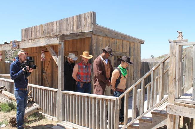 Videographer Mike Thompson shoots a lineup of cast members as convicts, from left, Jake Alberda, Lucasz Sczerba, Ming Hukari and Kyle Vonn Elzey 