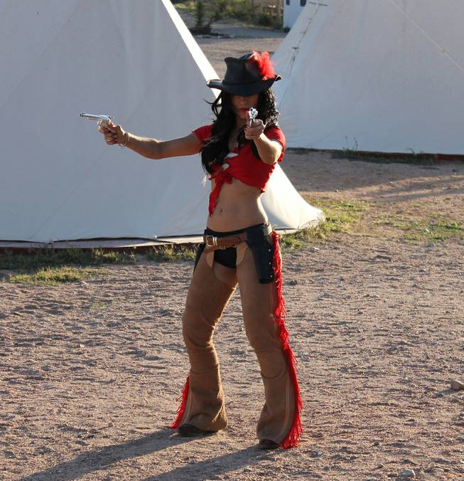 "Melody Sweets fires away during the video shoot for Sweets' ""Shoot 'em Up"" at Grand Canyon Ranch on April 22, 2014."