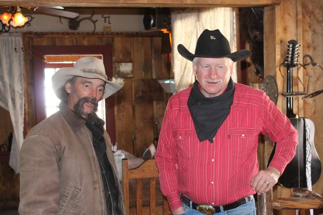 """The Singing Cowboy,"" Casey Adams, right, and his sidekick who came to be known only as Dusty, during the video shoot for Melody Sweets' ""Shoot 'em Up"" at Grand Canyon Ranch on April 22, 2014."