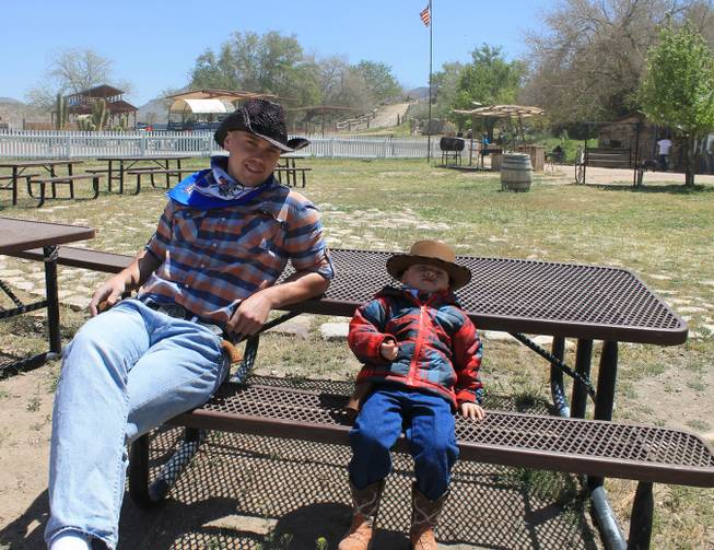 "Sergie Matvienko and his son, Yuryi, during the video shoot for Melody Sweets' ""Shoot 'em Up"" at Grand Canyon Ranch on April 22, 2014."