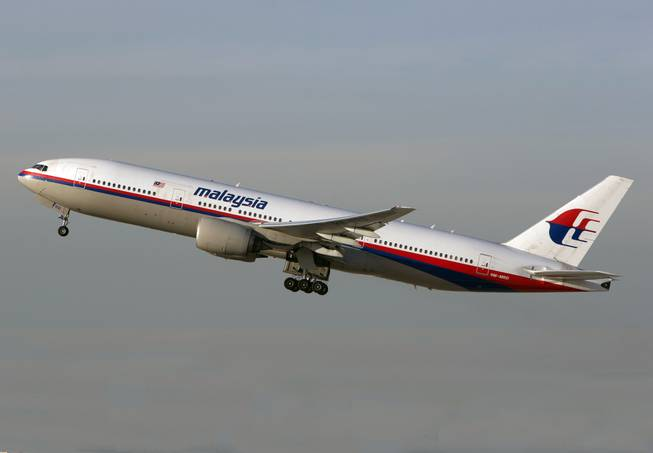 In this Nov. 15, 2012 photo, a Malaysia Airlines Boeing 777-200 takes off from Los Angeles International Airport in Los Angeles. The plane, with the tail number 9M-MRD, is the same aircraft that was heading from Amsterdam to Kuala Lumpur on Thursday, July 17, 2014 when it was shot down near the Ukraine Russia border.