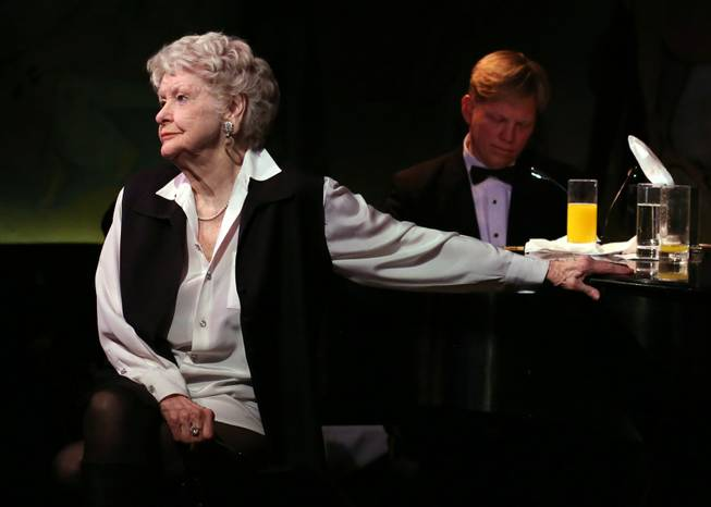 This April 2, 2013, file image released by the O+M Company shows Elaine Stritch performing her final engagement at the Cafe Carlyle in New York with Rob Bowman at the piano. Stritch died Thursday, July 17, 2014, at her home in Birmingham, Mich. She was 89.