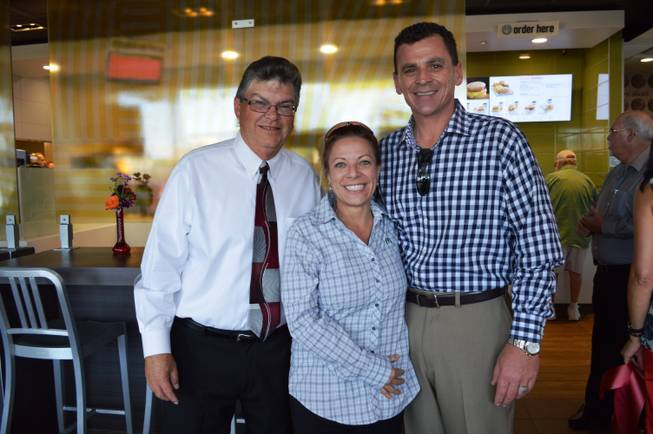 Caption: Owner of a new McDonald's location in Las Vegas, Tim Thomas (left), poses for a photo at the grand opening with fellow McDonald's operators Samantha Kiel and Michael Kiel.