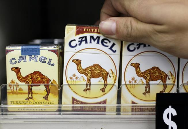 In this Feb. 1, 2011, photo, Camel cigarettes, an R.J. Reynolds product, are on display at a liquor store.