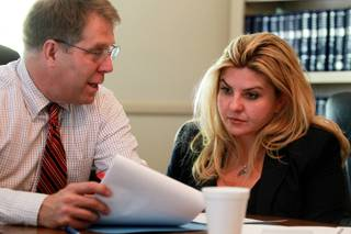 Michelle Fiore meets with legal counsel Craig Mueller May 8, 2014.