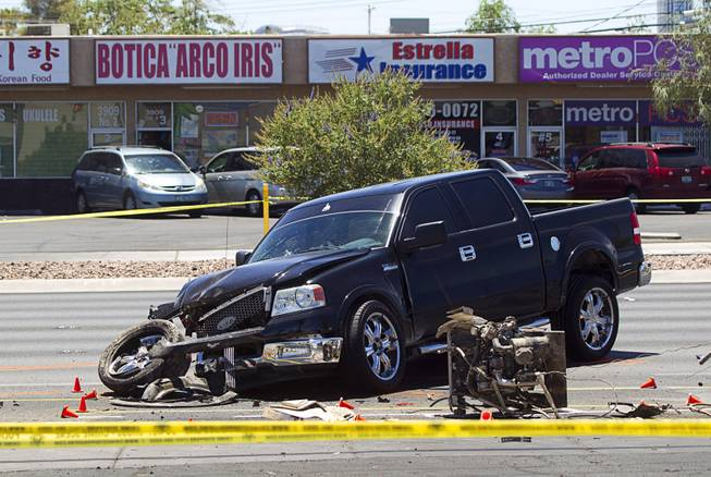 A pickup truck is shown at the scene of a fatal accident on Sahara Avenue near Valley View Boulevard Sunday, July 20, 2014. A man who was apparently working on the sidewalk was killed in the accident.