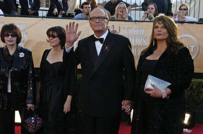 "James Garner arrives with his family, including his wife Lois Clarke, far left, for the 11th annual Screen Actors Guild Awards in this Saturday, Feb. 5, 2005, file photo taken in Los Angeles. He was given the 41st annual life achievement award at the show. Garner, wisecracking star of TV's ""Maverick"" who went on to a long career on both small and big screen, died Saturday, July 19, 2014, according to Los angeles police. He was 86."