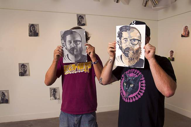 Photographer Todd Duane Miller, left, and artist JW Caldwell pose in the P3 Studio in the Cosmopolitan Monday, July 21, 2014. For their project, Miller combines portraits of people and Caldwell creates artwork from the composite photos. The photo displayed is half Miller (left side) and half Caldwell.